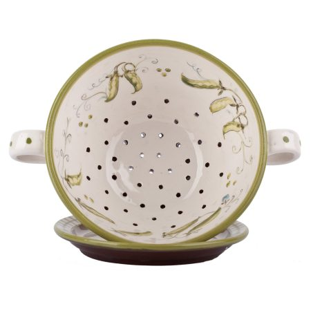 A photo of a handmade ceramic Colander and plate set