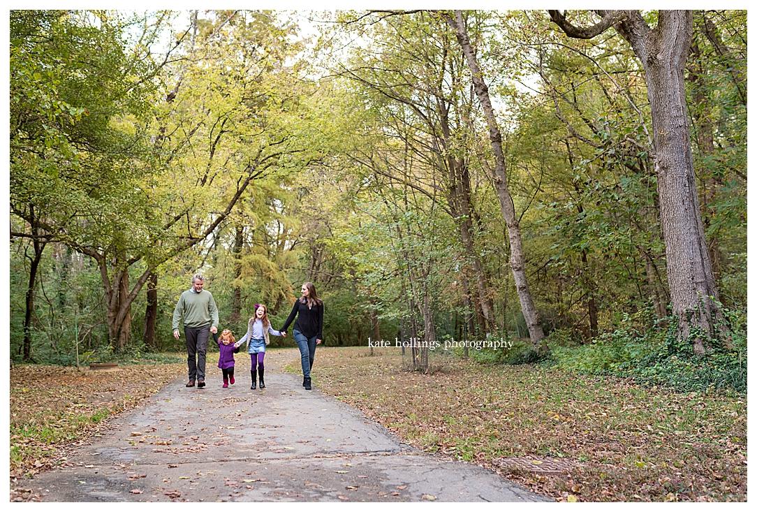 Family of four takes a fall walk