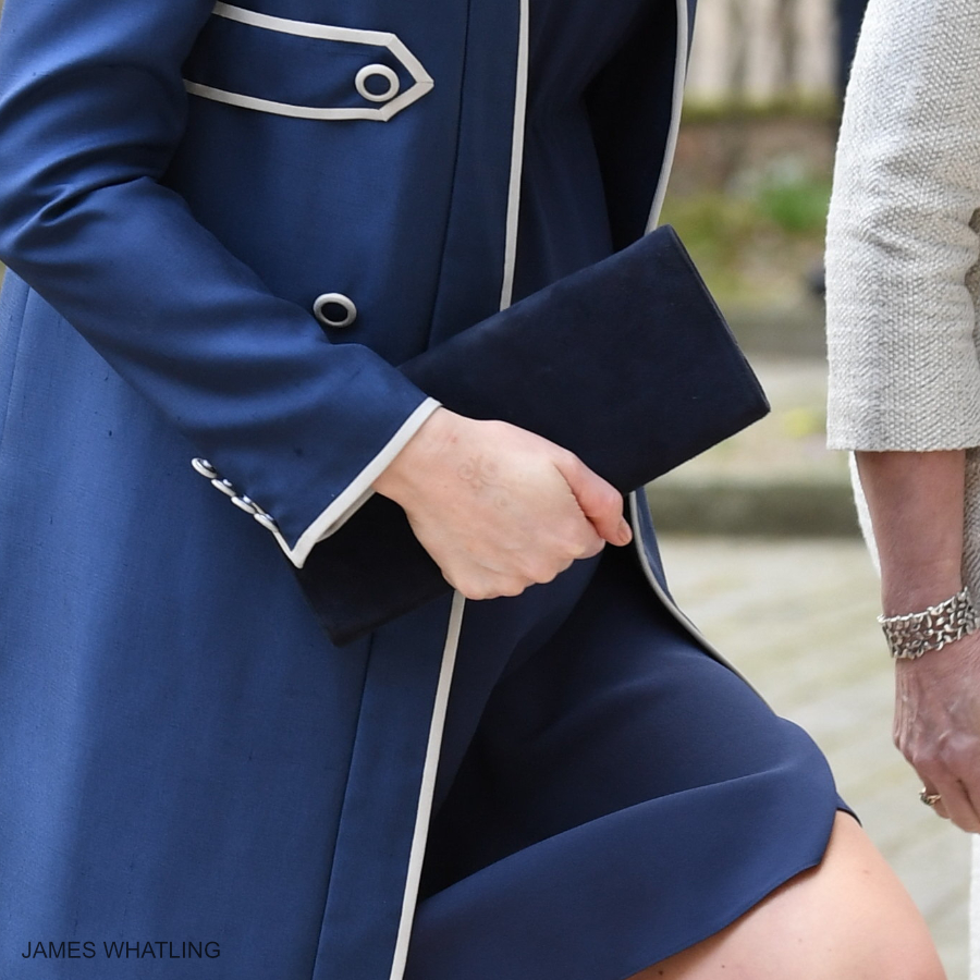 """Kate Middleton carrying the blue suede """"Muse"""" clutch bag by Stuart Wetizman"""