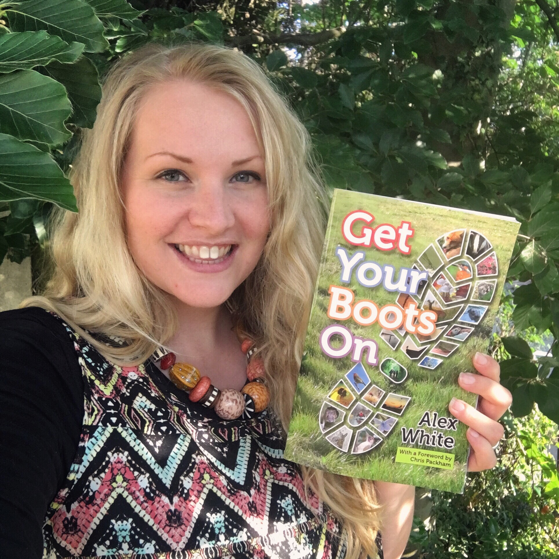 kate on conservation holds up Get Your Boots On book by Alex White
