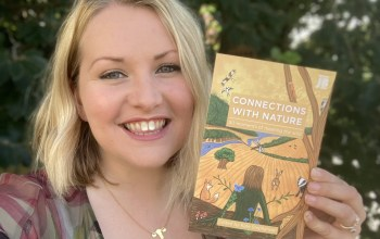Kate on Conservation holds Connections with Nature book