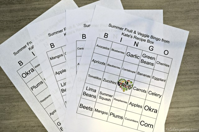 A stack of bingo boards with a grid of 5 x 5 boxes. Each space features a different item of summer produce. The middle square is a free space.