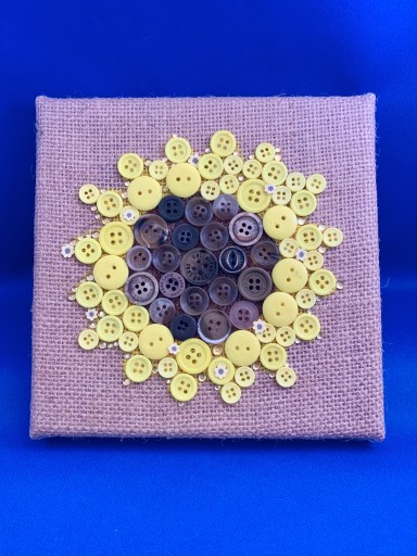 Vintage button wall art with sunflower cane slices from Kater's Acres