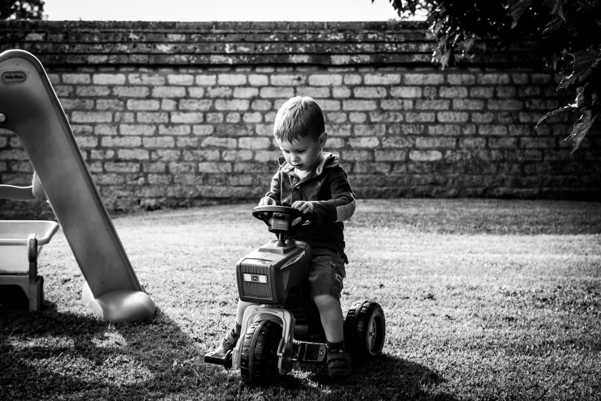 Boy on tractor, Kate Stoddart-Scott Photography