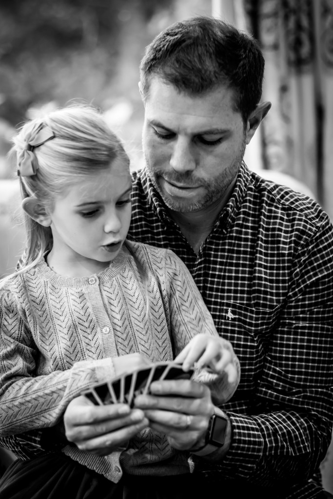 Father and daughter playing Uno, the art of storytelling