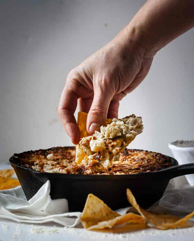 Big chunks of hearts of palm with tons of parmesan cheese take artichoke dip to above and beyond even the best spinach and artichoke dip.