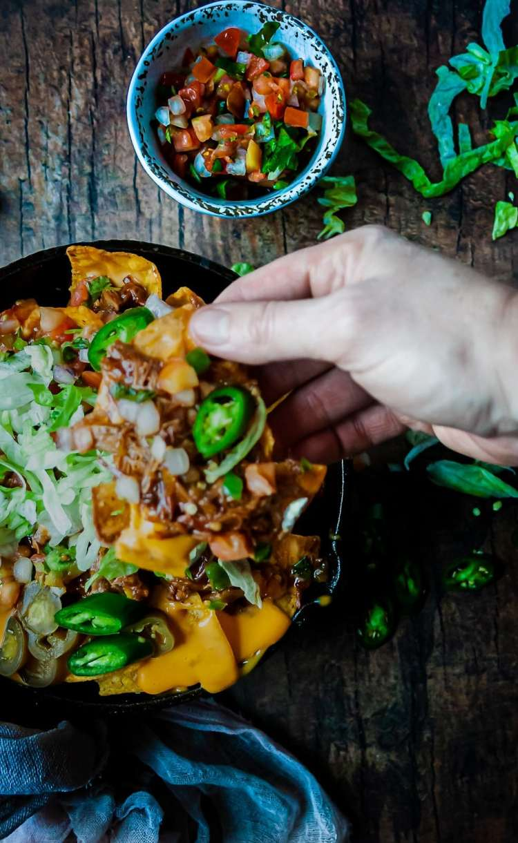 Digging into the best pulled pork nachos