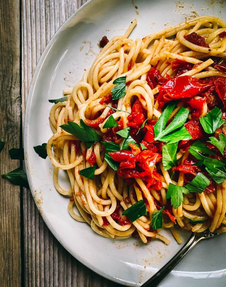 This easy oven roasted tomato sauce recipe is perfect on a plate of spaghetti