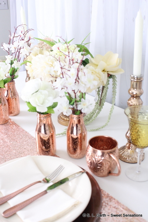 ivory and copper tablescape