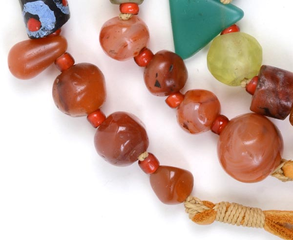 """Talisman for Grounding 1"" detail showing Djenne Carved Carnelian, Bohemian Vaseline Bead"