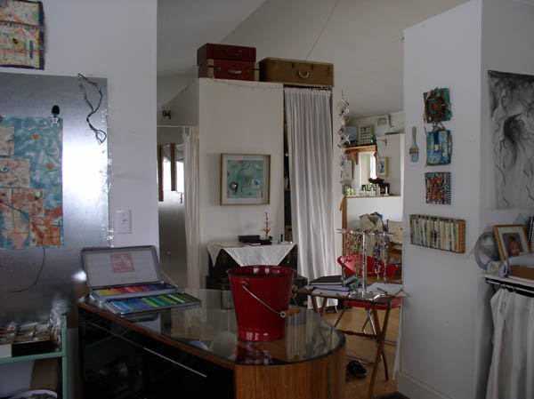 """View from the studio with """"Talismans for Eastern Bluebirds"""" on the central wall and a few talismans on the wall to the right."""