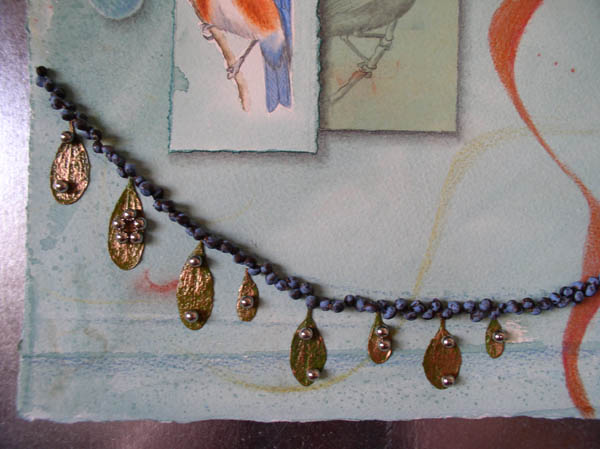 "Kathleen O'Brien, ""Talisman for Western Bluebirds"", process, showing mistletoe glued using magnets"