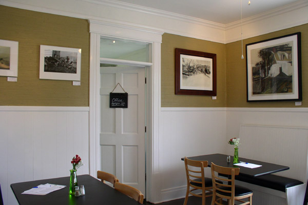 Grace Cafe, dining area with art by Nick Lacy and Rochelle Bayless & office