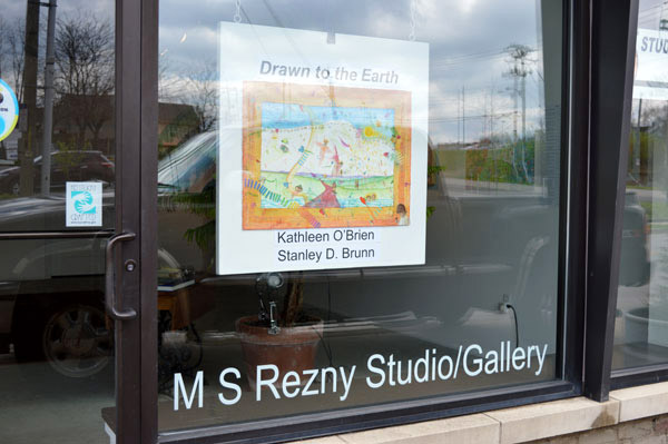 "Front window at MS Rezny Studio/Gallery for ""Drawn to the Earth"""