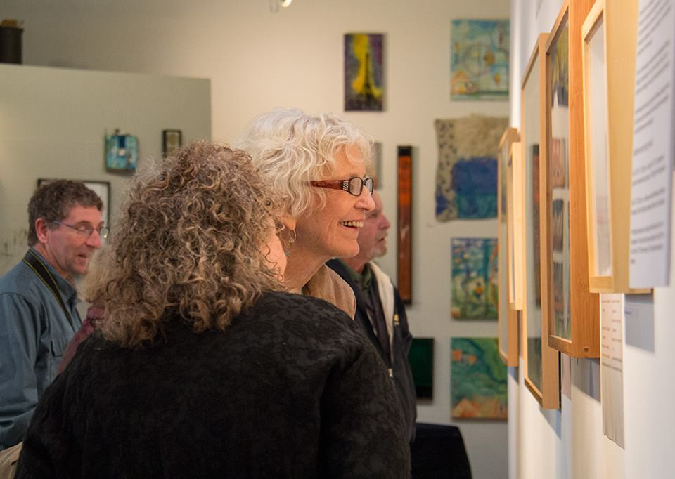 "Elsie Harris looking at ""Walls and Gates"", photo credit Melissa Hall"