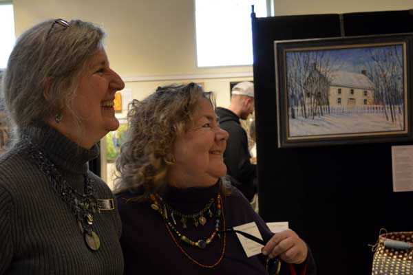 """Angela Selter and I talking about the art at """"225: Artists Celebrate Kentucky's History"""" reception: photo, Greg Orth"""