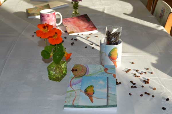 Orange Bellied Parrot & Autumn Light Notebook+Mug & coffee sets by Kathleen O'Brien