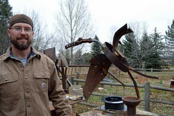 Matthew Jarrett with his Heron sculpture