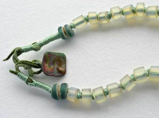"""© Kathleen O'Brien, Talisman for Harmony, knotted necklace, opalized glass 1800, Dutch annular beads 1700, Raku button, 23"""""""
