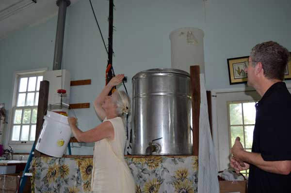 Jennifer Gleason with the hoist in the Soapmaking area in the Sunflower Sundries Market Shop