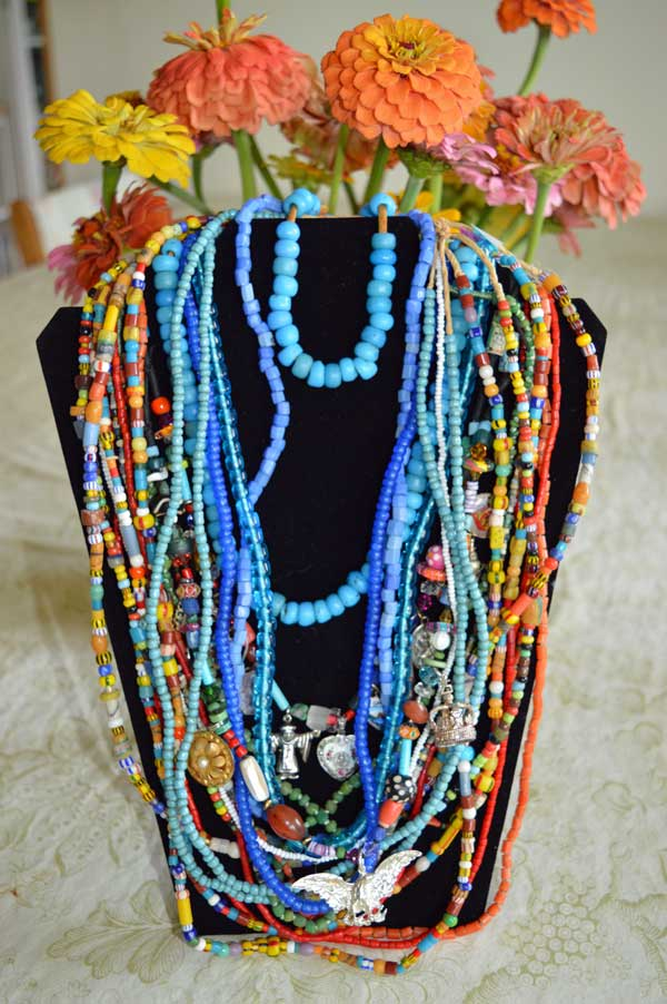 A bunch of bead necklaces and Zinnias