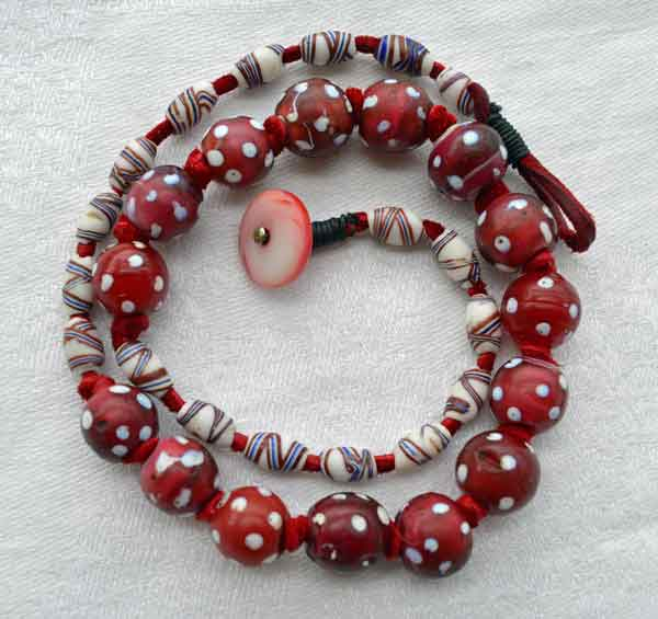 White heart skunk bead necklace by Kathleen O'Brien