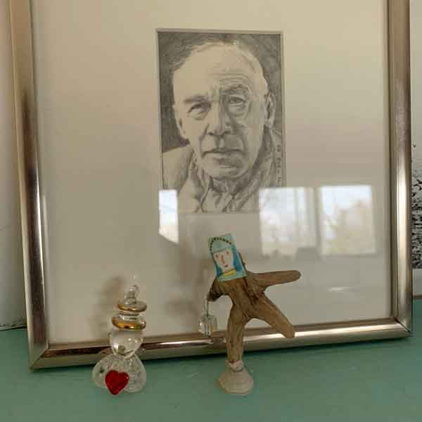 "©Kathleen O'Brien, drawing of Henry Miller, 1983,on a studio shelf with 2 mini sculptures, one with HM's painting of ""Antoine the Clown"" on a Big Sur driftwood body"