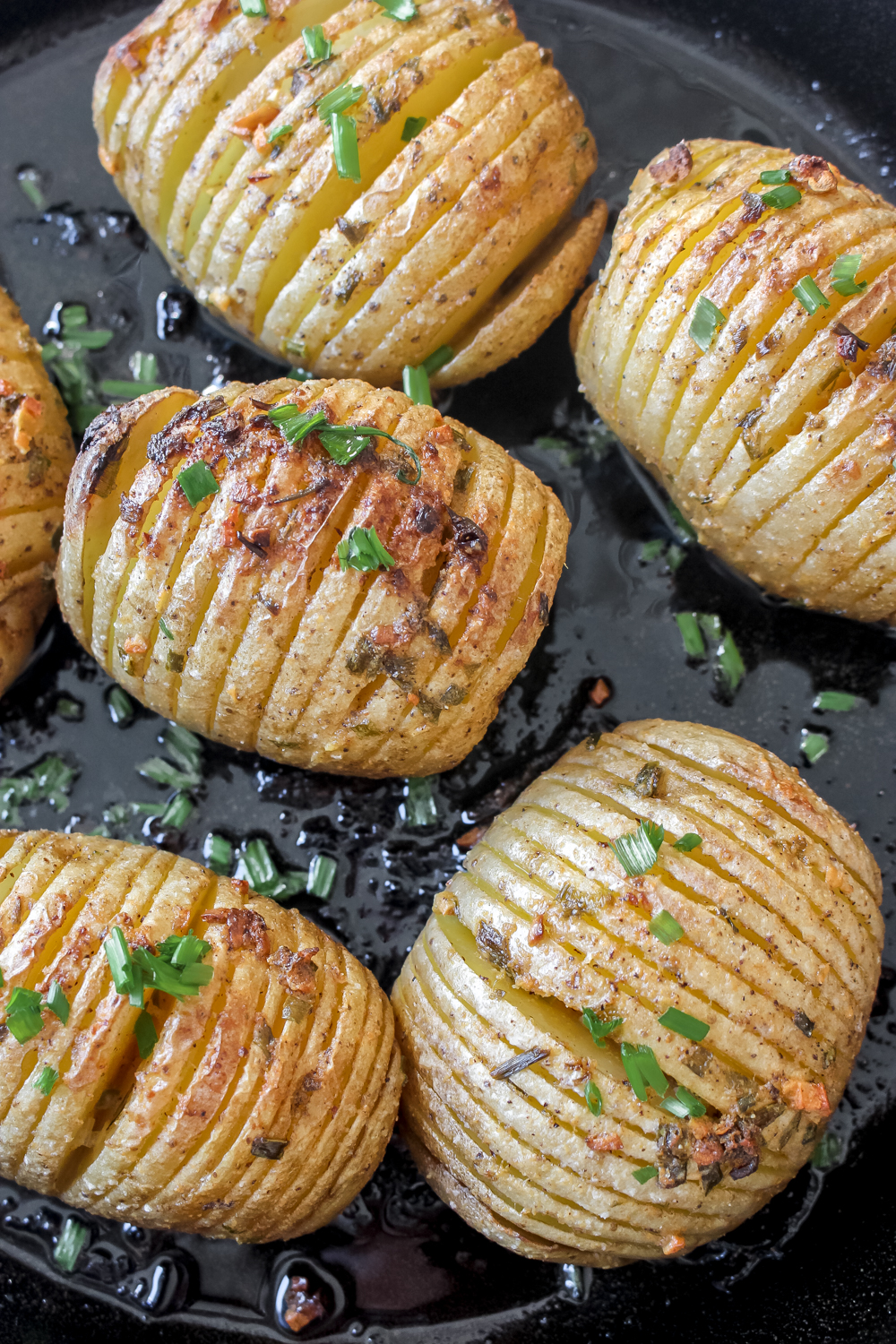 Hasselback Potato Skillet with Mustard Garlic Butter + Chives