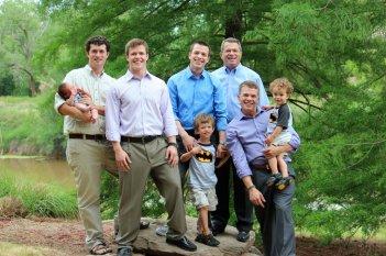 Mark holding Jacob, Peter, Adam, Elijah, Ron, David holding Colin