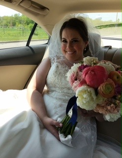 My on my wedding day - with my amazing bouquet