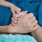 Mom and Kat holding hands