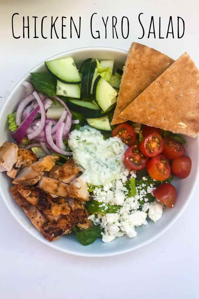 Filling, Fresh, and Flavorful. All the flavors of a gyro, but in salad form. Marinated grilled chicken packs a protein punch and n easy, homemade tatziki sauce pulls everything together. Serve the salad family style and let everyone assemble their own bowls. #KathleensCravings #Greeksalad #GreekGyroSalad #GrilledChickenSalad #GrilledGreekChicken