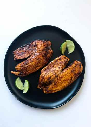Tilapia fillets are glazed and baked with an easy Chili Lime marinade that has just the right amount of kick. Serve the Chili Lime Tilapia with rice and steamed vegetables or some fruit salsa for an easy, fresh, and fun weeknight dinner.
