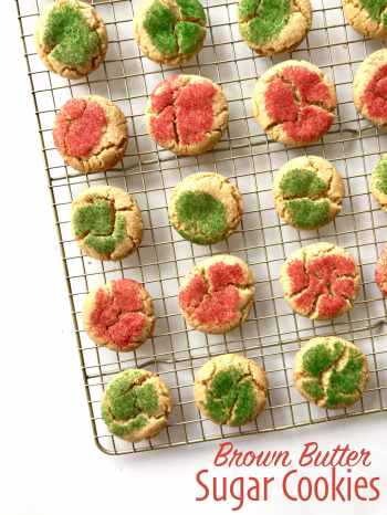 Brown Butter Sugar Cookies with holiday sprinkles on a cooling rack