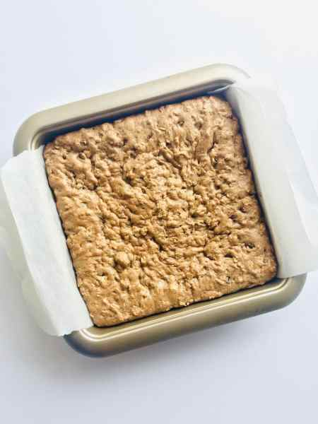 Soft and gooey in the middle, made with wholesome, healthy ingredients, and easy to mix up. These Healthy Oatmeal Cookie Bars are perfect any time of day! Adult and Kid-friendly, these bars taste like your favorite Oatmeal Cookie without any of the guilt. Recipe at KathleensCravings.com #healthybaking #healthysweets