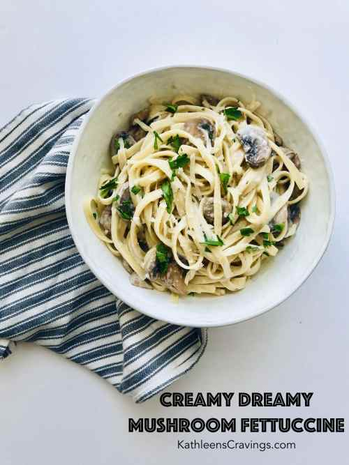 Mushroom Fettuccine is rich and decadent enough to make on a Saturday night alongside a bottle of wine. But easy enough with just a few ingredients to make on a weeknight. Lots of butter, cream, parmesan, and mushrooms. What's not to love? Recipe at KathleensCravings.com #creamypasta #mushroompasta