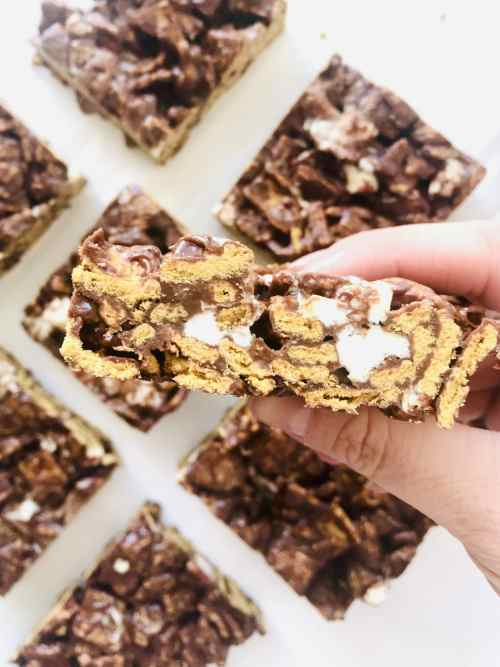 These Cereal S'Mores Bars honestly can't be beat. I'm talking gooey, sticky, crunchy, just a few ingredients, and no baking needed. Recipe at KathleensCravings.com #nobakedessert #cerealtreats #nobakebars