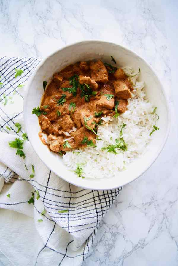 Recreate your favorite Indian takeout meal with this easy Slow Cooker Butter Chicken. Just dump all the ingredients in your crock-pot, set it, and forget it. Recipe at KathleensCravings.com #SlowCookerIndian #EasyIndianFood #TakeoutFakeout