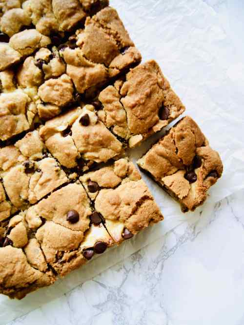 Baked and cut Chocolate Chip Cookie Cheesecake Bars