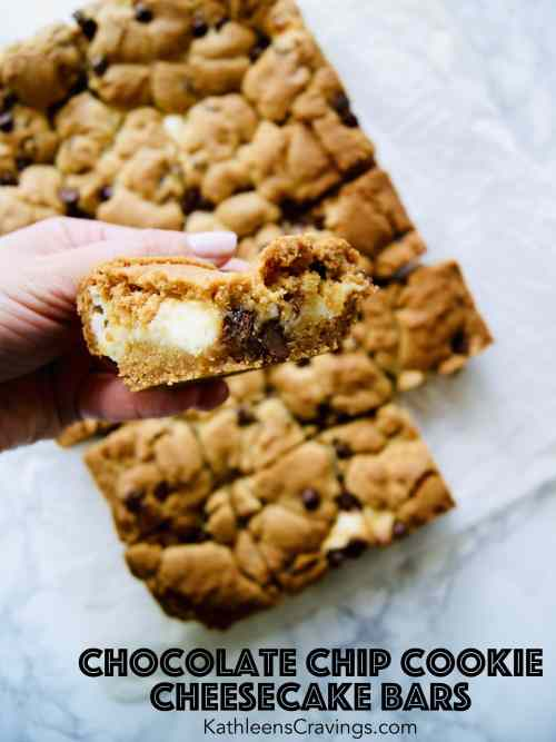 Chocolate Chip Cookie Cheesecake Bar being held to show the layers