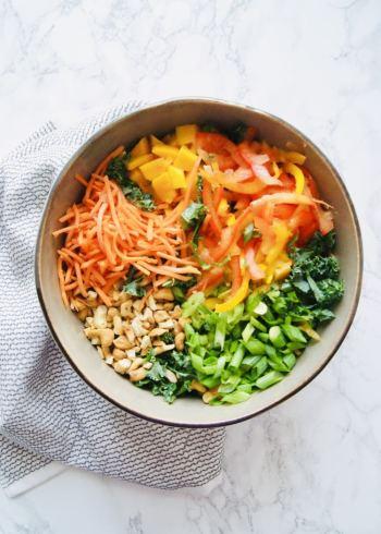 Thai salad ingredients in a large bowl