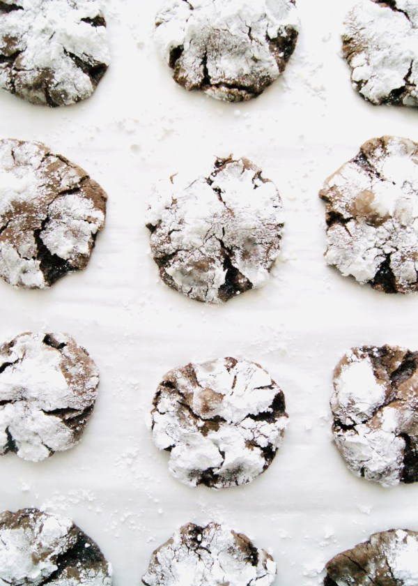 Chocolate Crinkle Cookies are a traditional Christmas Cookie and always a crowd favorite. These chocolate cookies are thick, soft, and resemble a brownie in a cookie! Recipe at KathleensCravings.com #kathleenscravings #christmascookies #holidaycookies #chocolatecookies #crinklecookies