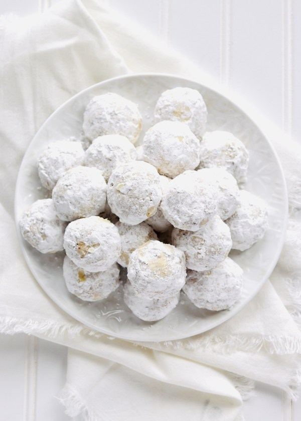 Snowball Cookies with Pecans are always one of my favorite holiday cookies. They are buttery, tender, nutty from the chopped pecans, and covered in sweet powdered sugar. They're a Christmas classic. Recipe at KathleensCravings.com #kathleenscravings #snowballcookies #pecancookies #christmascookies #holidaycookies #Russianteacakes