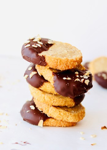 chocolate dipped brown butter almond shortbread cookies stacked