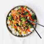 Cashew Veggie Stir-Fry is the perfect plant-based meal for meatless Monday. Loaded with veggies like bell peppers, broccoli, zucchini, and carrots. Diced fresh pineapple adds sweetness. Recipe at KathleensCravings.com #kathleenscravings #stirfry #veggiestirfry #plantbased #cleaneating #vegetarian #vegan #meatlessmonday #cashews