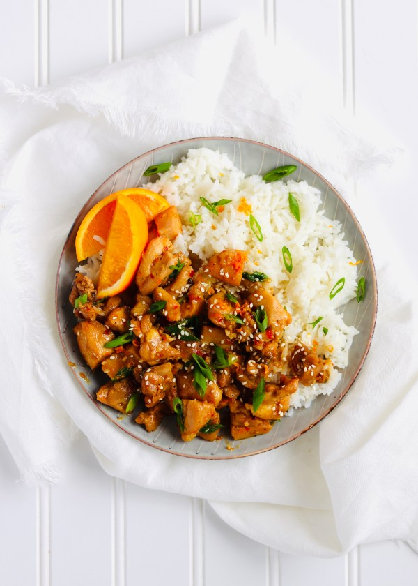Healthy Orange Chicken satisfies your takeout craving without the frying. Just marinate chicken thighs in an easy orange marinade for an easy, flavorful weeknight dinner or healthy meal prep. Recipe at KathleensCravings.com #kathleenscravings #orangechicken #healthyorangechicken #healthymealprep #takeoutfakeout #chickenthighs