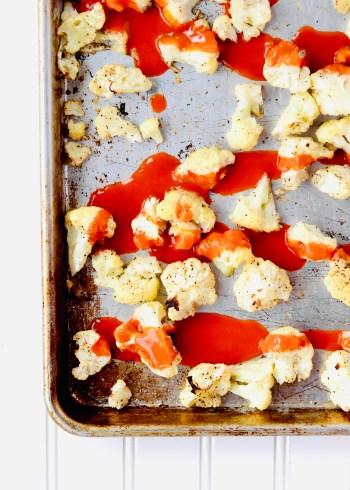 Roasted cauliflower and buffalo sauce on sheet pan