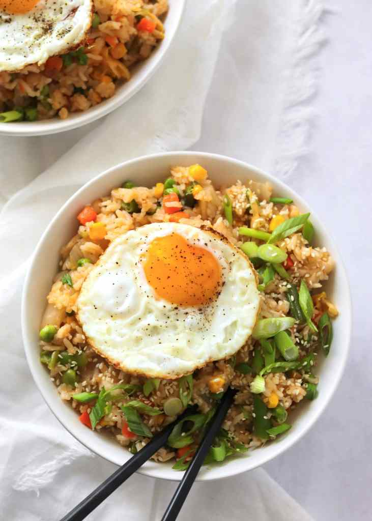 Kimchi fried rice in bowl with fried egg on top