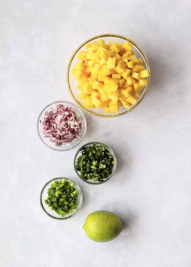 Pineapple, red onion, cilantro, jalapeño, and a lime.