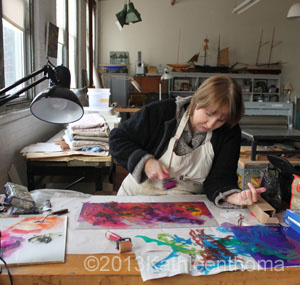 Kathleen Thoma creating a monotype in her studio